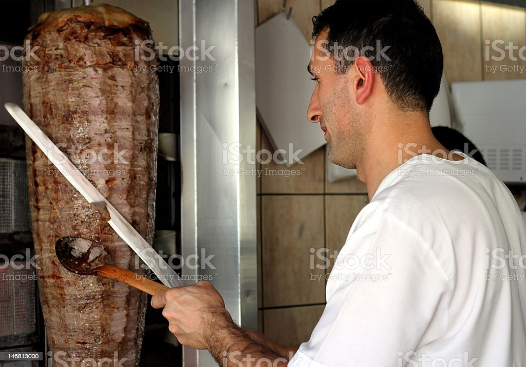Chef slicing Turkish doner kebab royalty-free stock photo