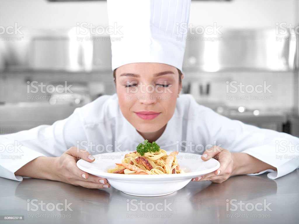 Chef smelling shrimp pasta stock photo
