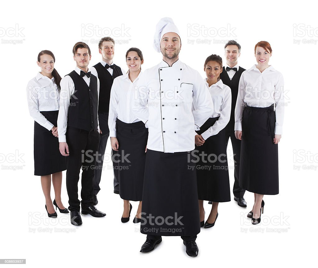 Chef standing in front of his team stock photo