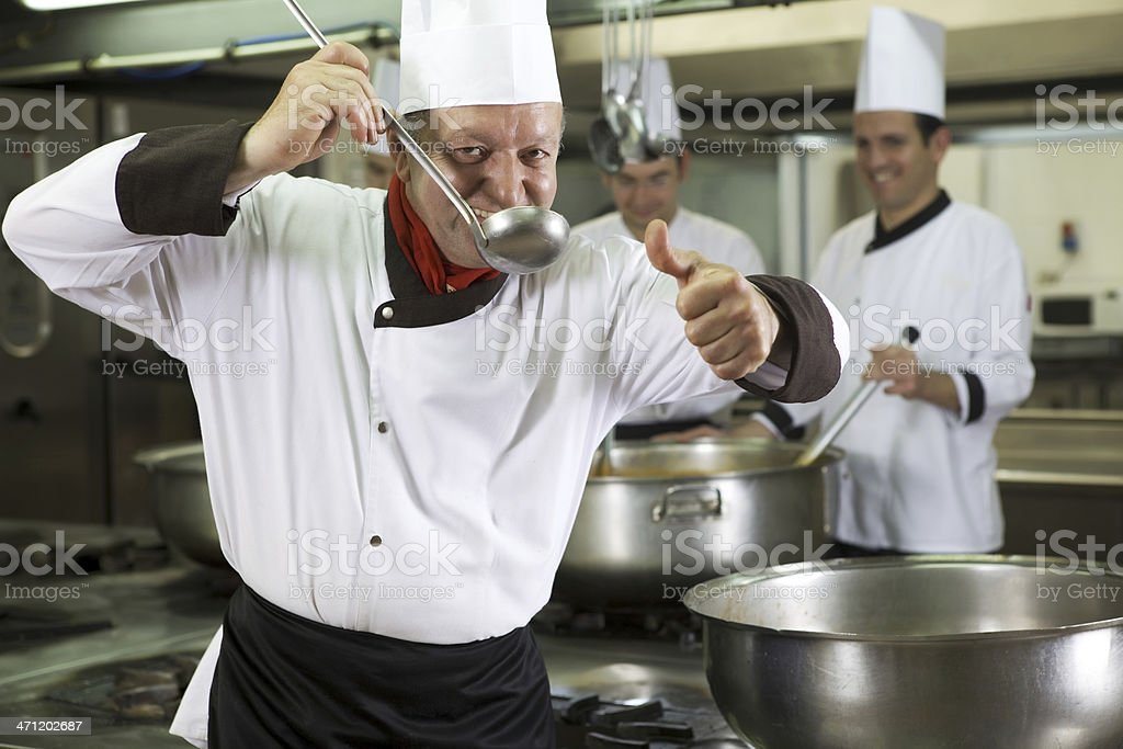 Chef tasting the food royalty-free stock photo
