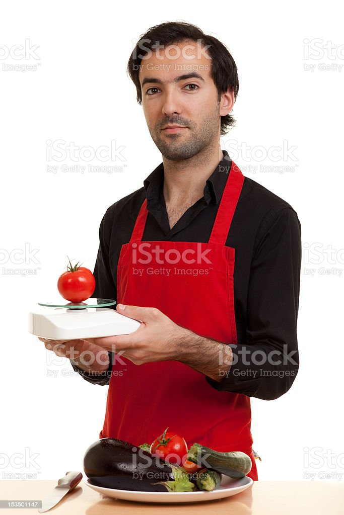chef tomatoe scale royalty-free stock photo