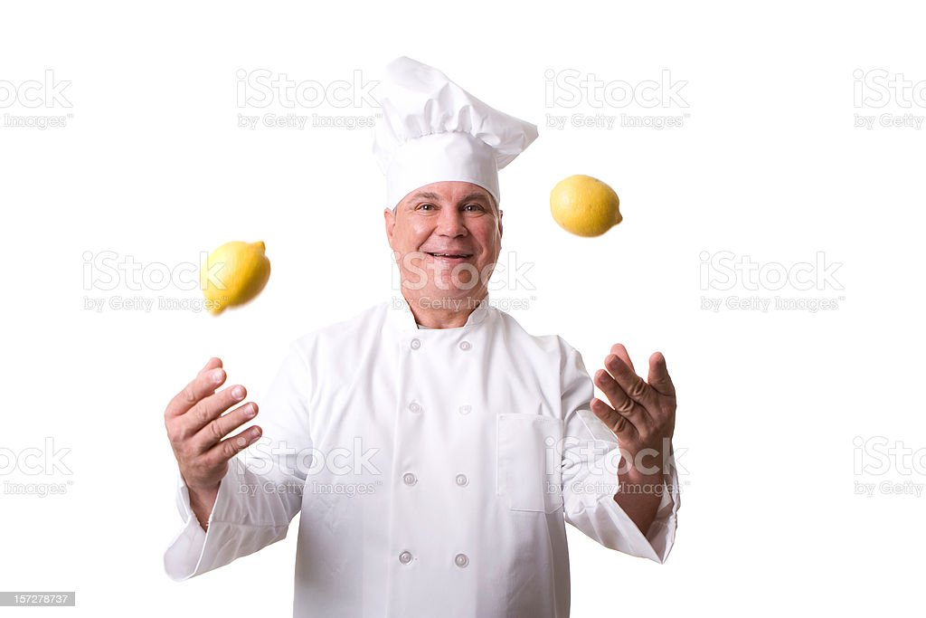 Chef Tossing Lemons royalty-free stock photo