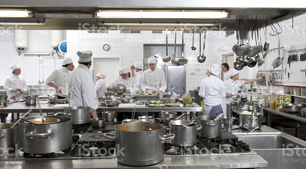 chef trainees preparing dinner stock photo