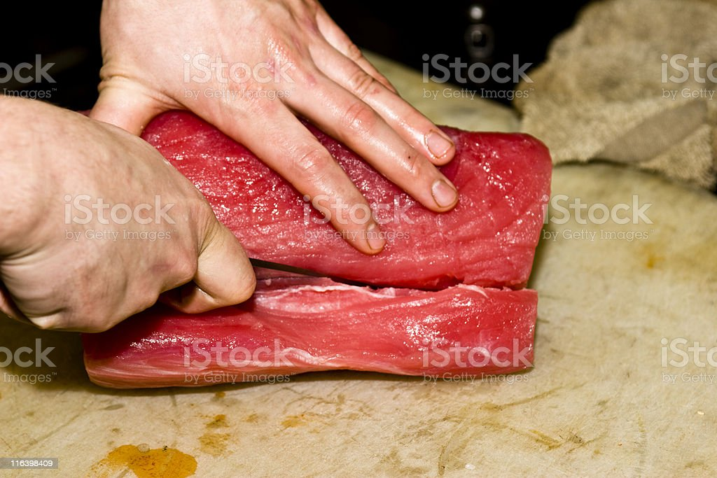 Chef trimming a piece of Ahi Tuna royalty-free stock photo