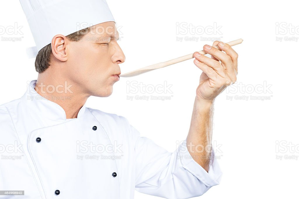 Chef trying meal. stock photo