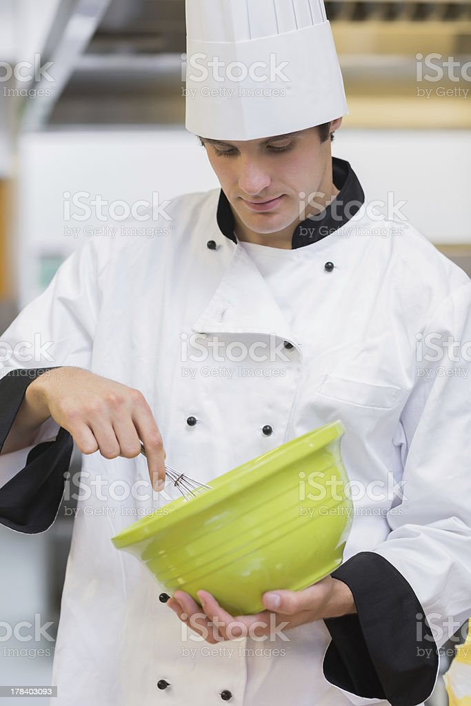 Chef whisking batter royalty-free stock photo