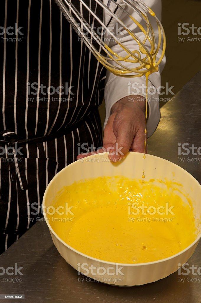 chef whisking egg mixture royalty-free stock photo