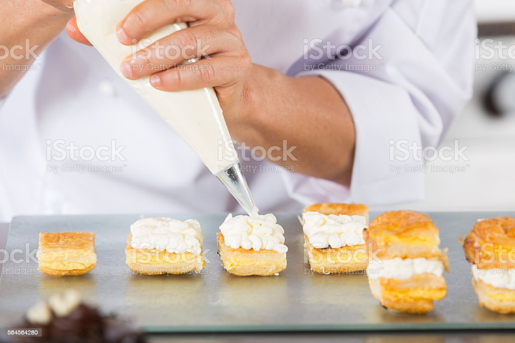 Chef with a pastry bag stock photo
