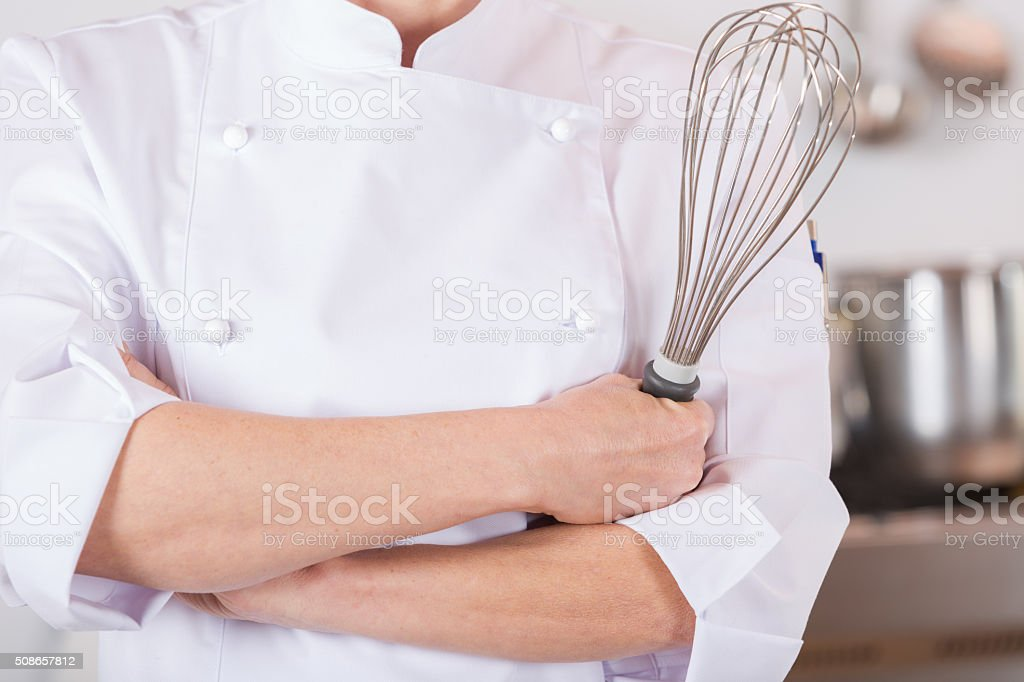 Chef with a whisk stock photo