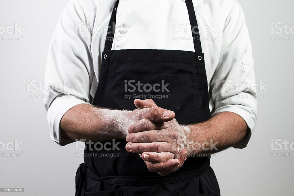chef with flour on hands stock photo