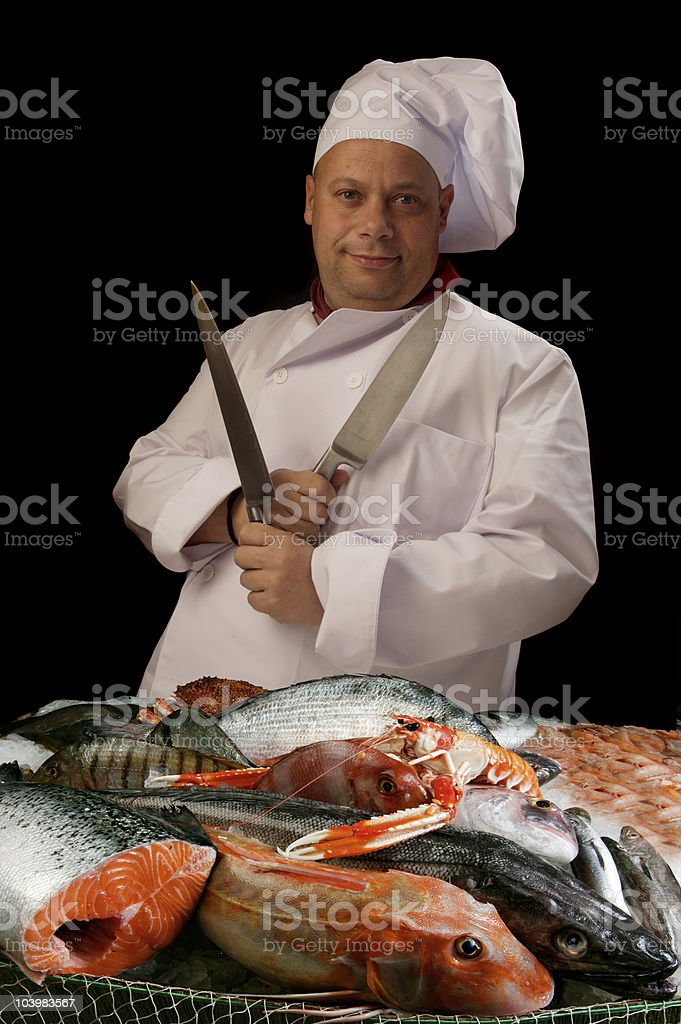 chef with knife and fishes royalty-free stock photo