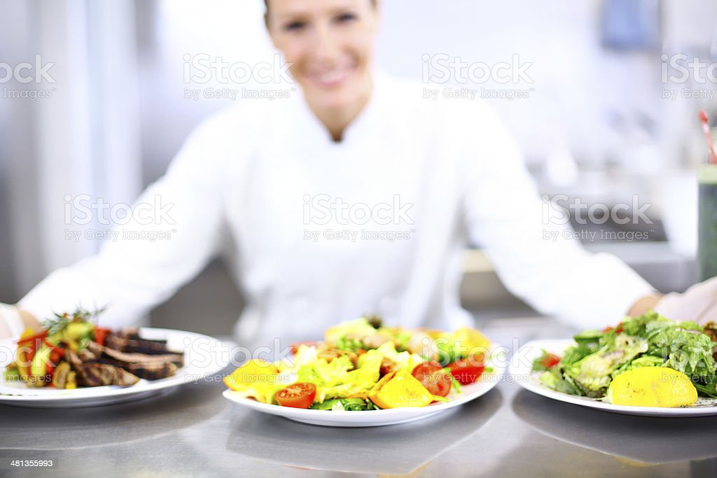 Chef with prepared meals. stock photo