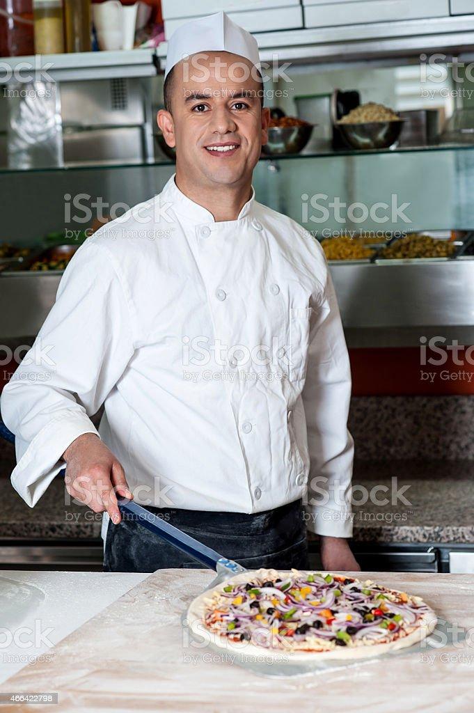 Chef with prepared pizza dough stock photo