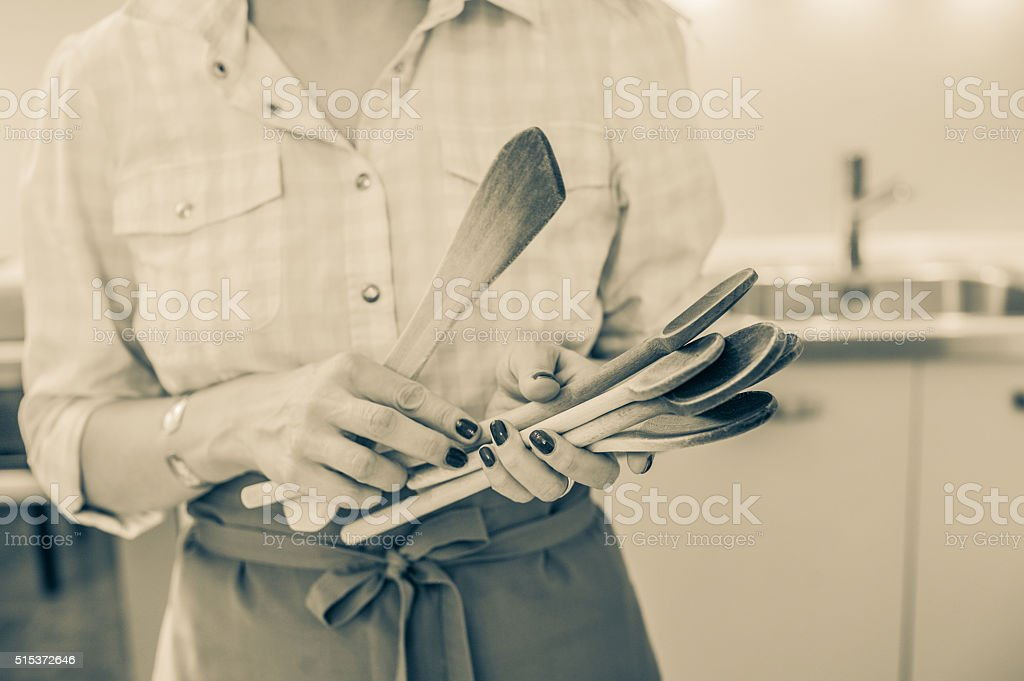 Chef with wooden spoons stock photo