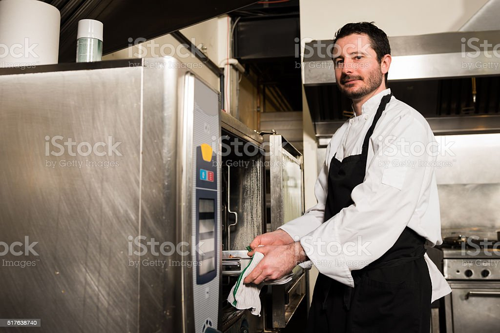 Chef working in a commercial kitchen stock photo