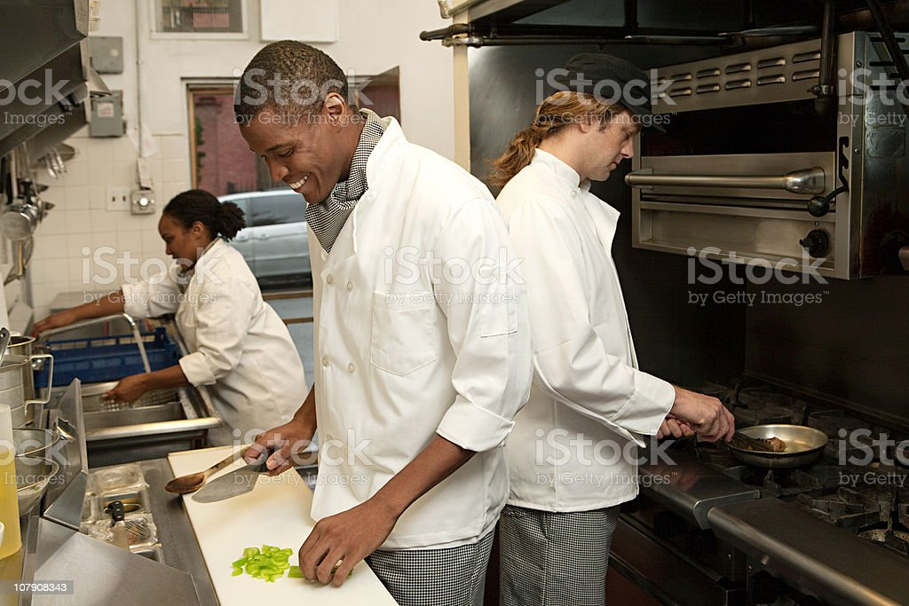 Chef working in commercial kitchen stock photo
