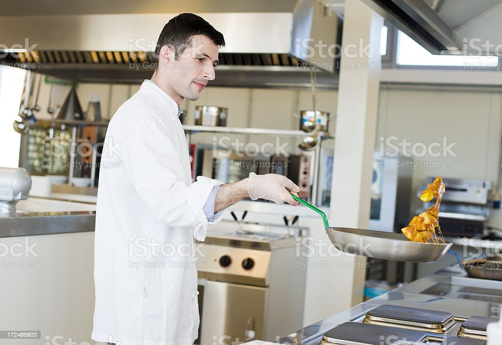 Chef working in kitchen royalty-free stock photo