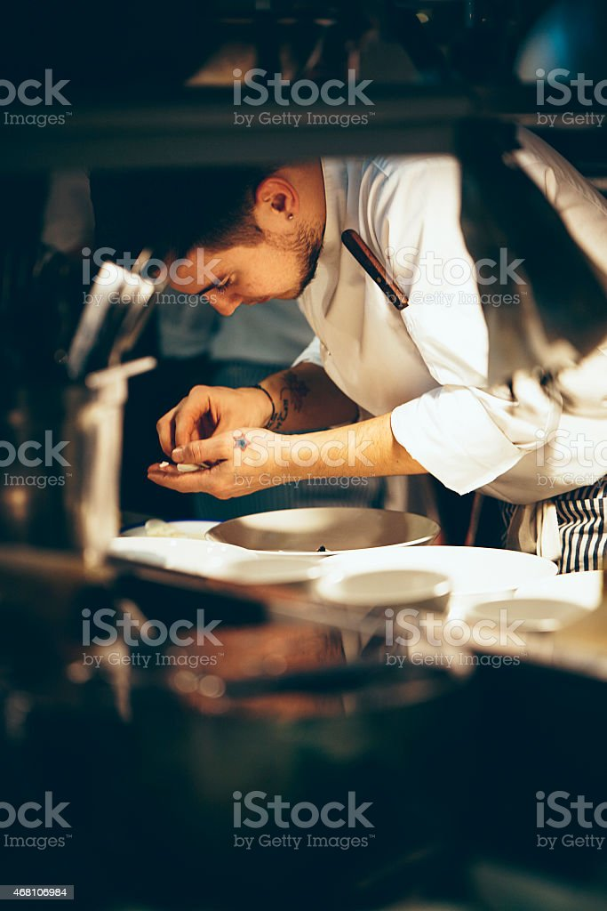 Chef working in kitchen stock photo