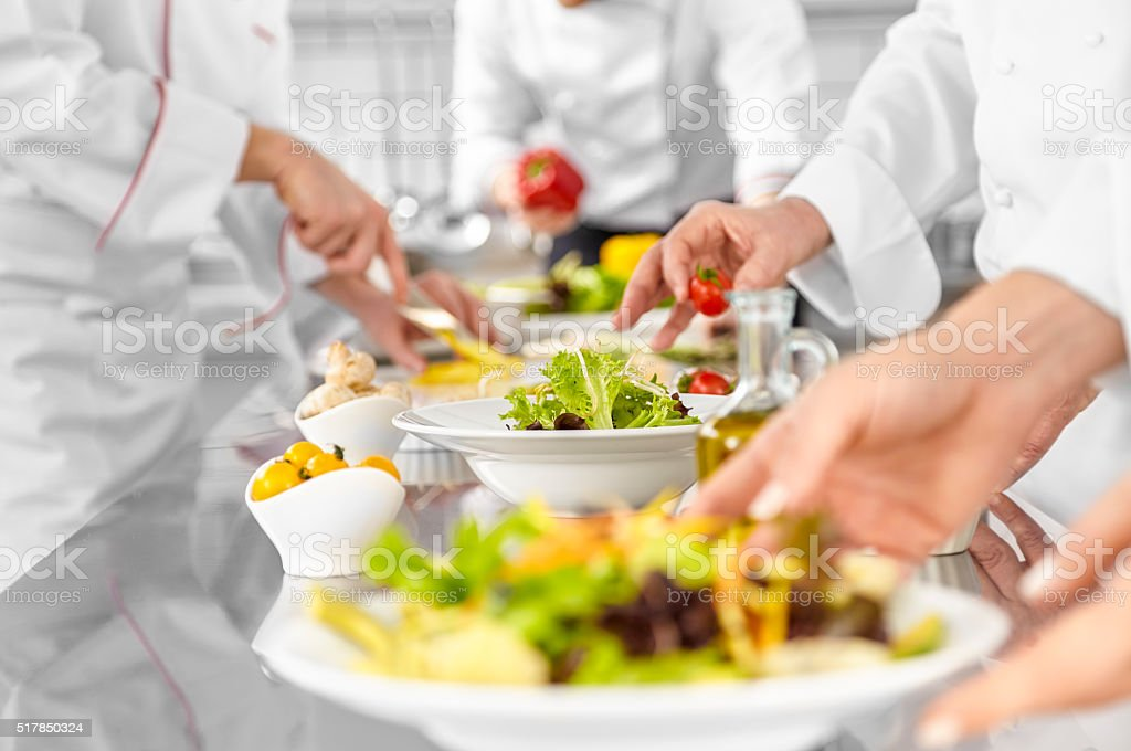 Chefs are preparing salads stock photo