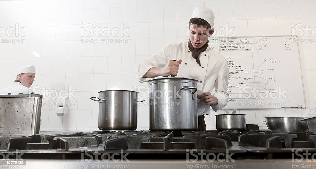 chefs cooking in restaurant kitchen royalty-free stock photo