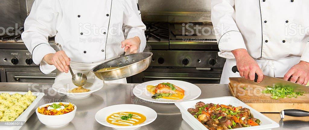 Chef's dishing up stock photo
