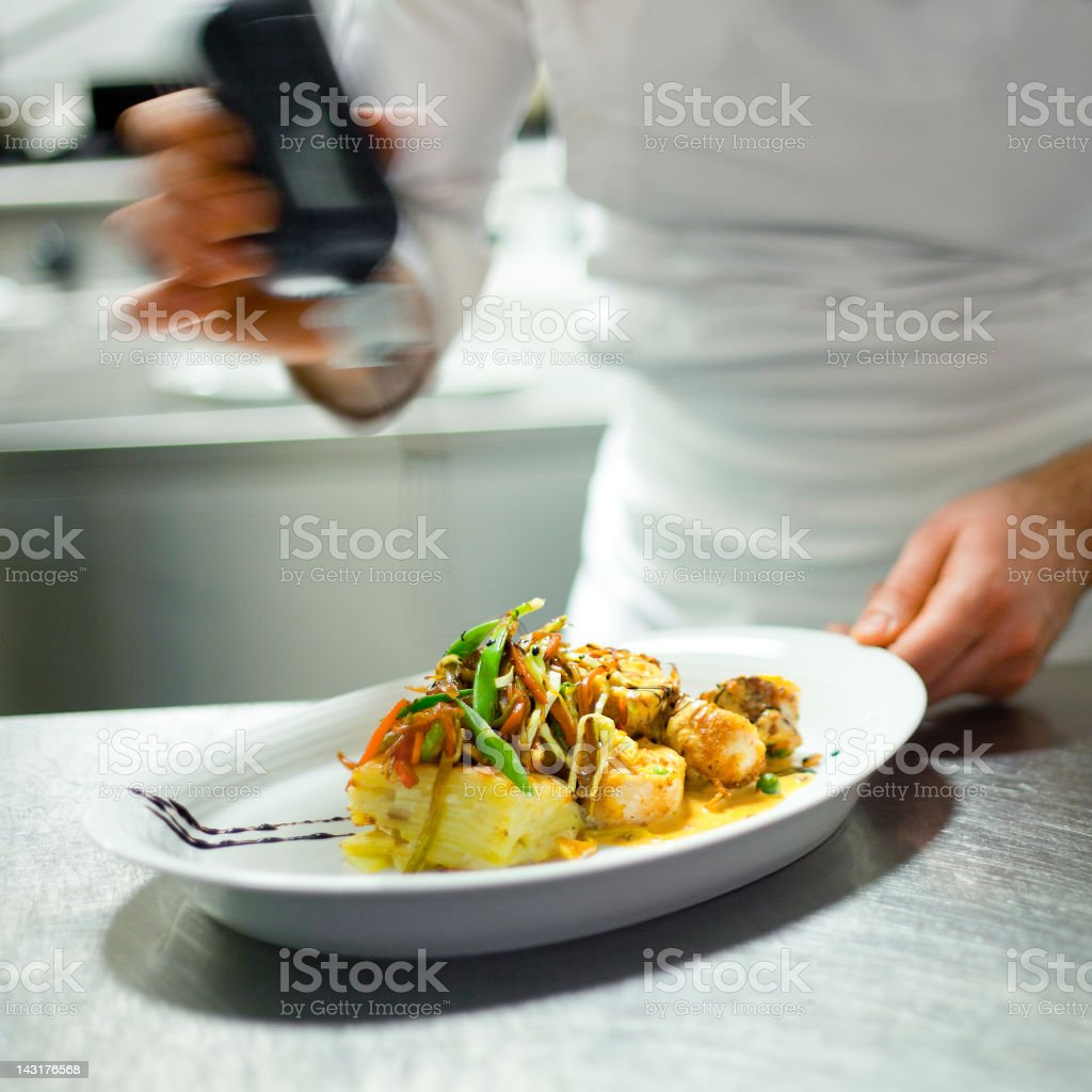 Chef's final touch royalty-free stock photo