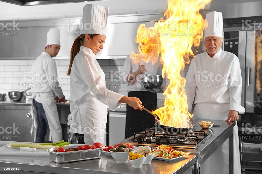 Chefs flame in the kitchen stock photo