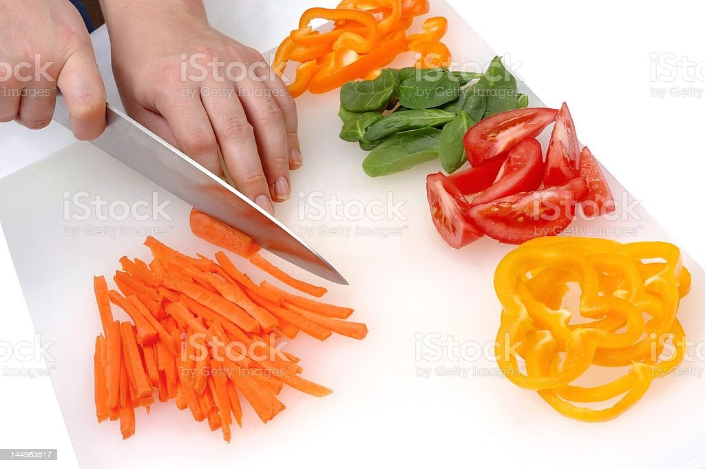 Chef's Hands Cutting Vegetables stock photo