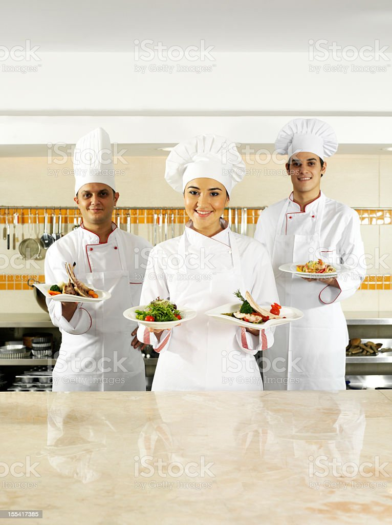 Chefs Holding Plates of Food royalty-free stock photo