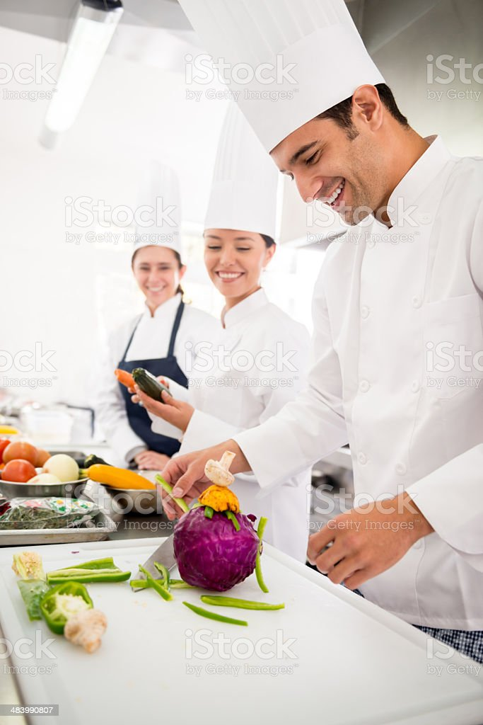Chefs in a cooking class stock photo