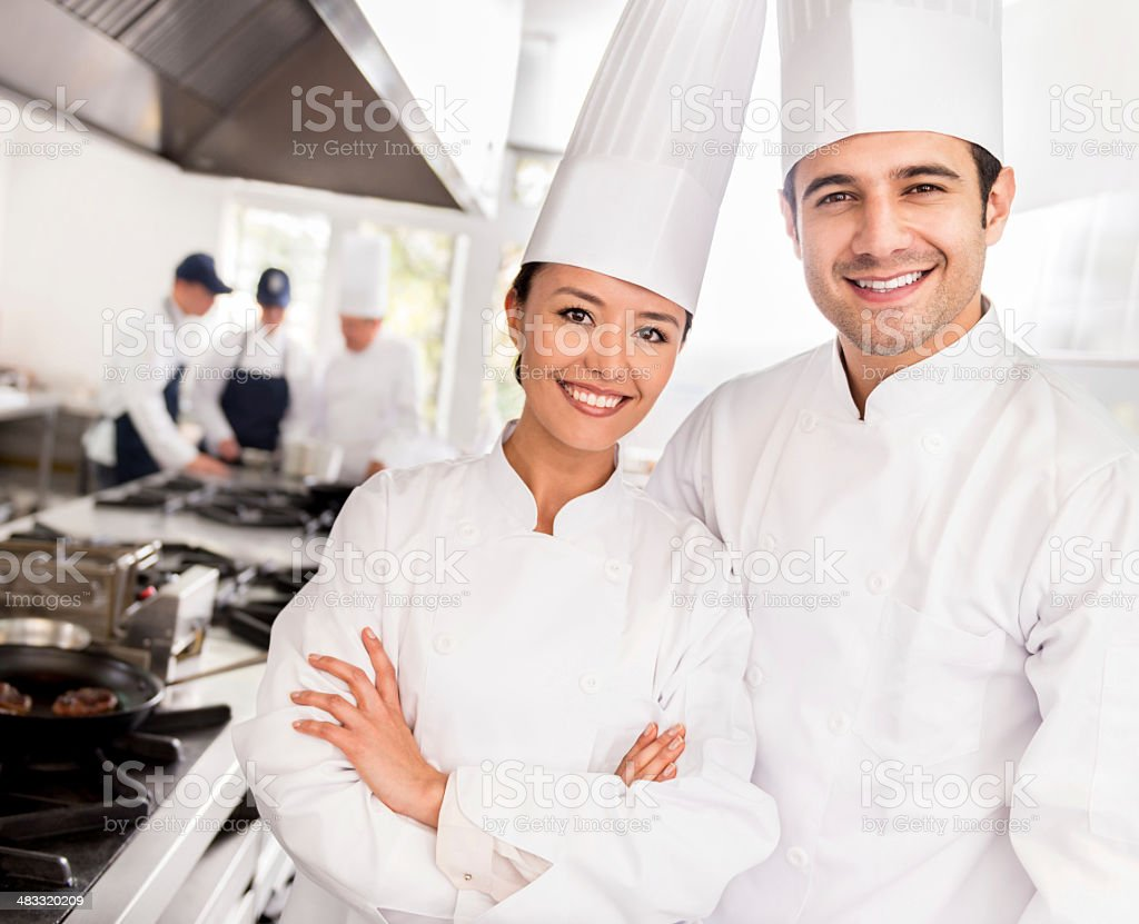 Chefs in a restaurant stock photo