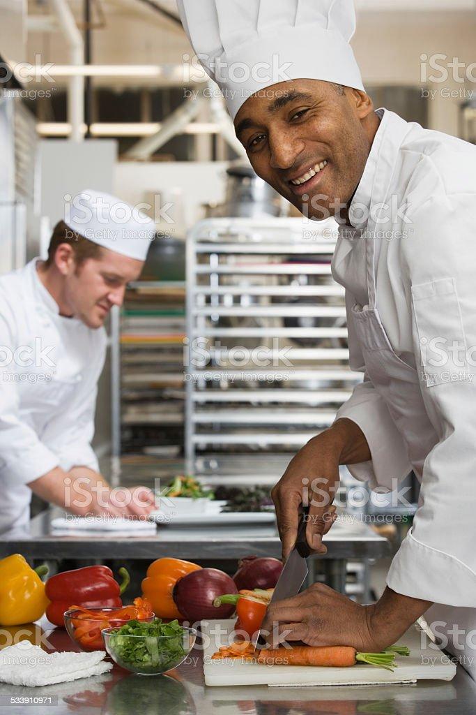 Chefs in kitchen stock photo