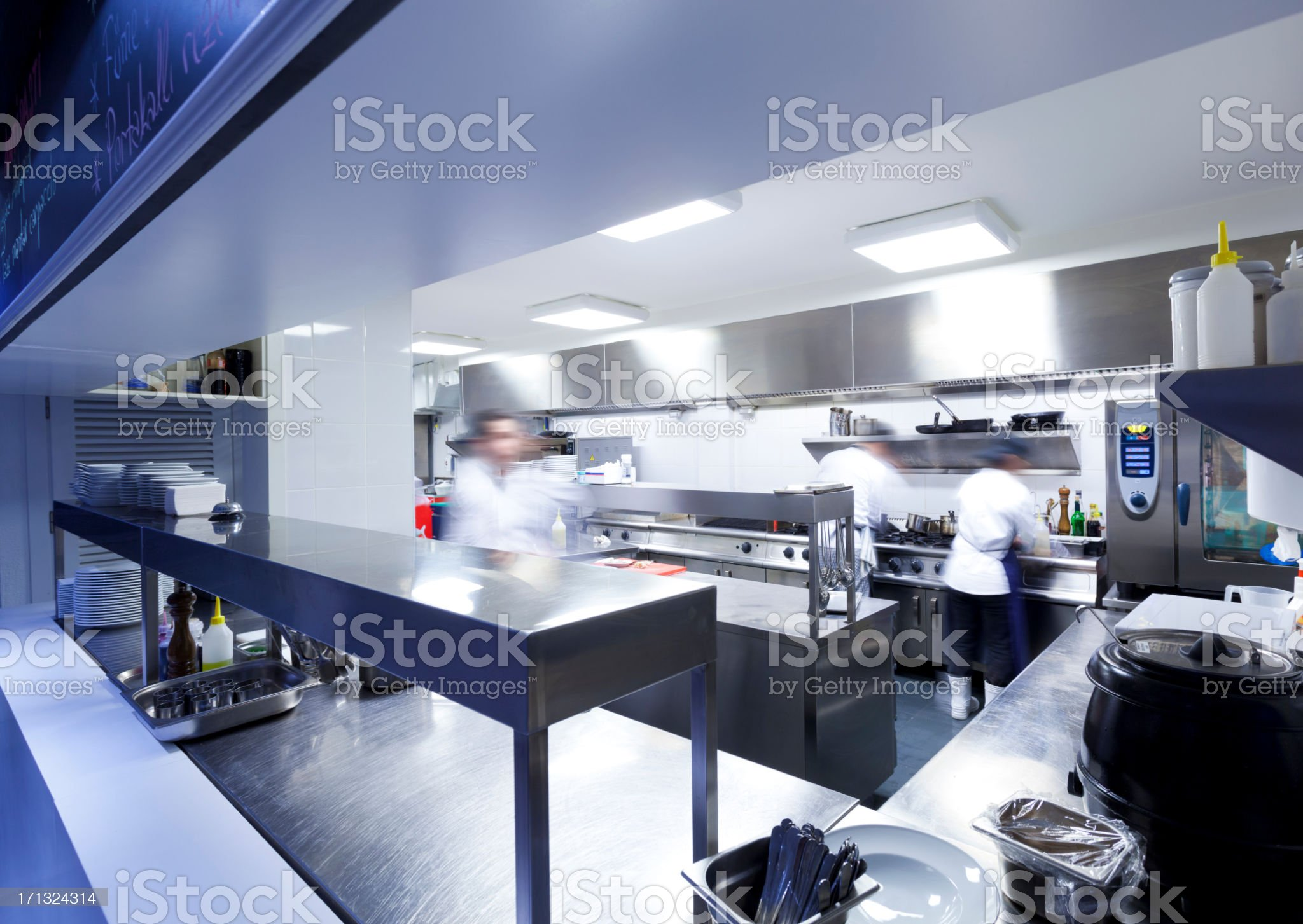 Chefs in the commercial kitchen royalty-free stock photo
