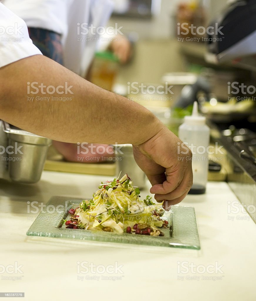 Chefs making a salad royalty-free stock photo