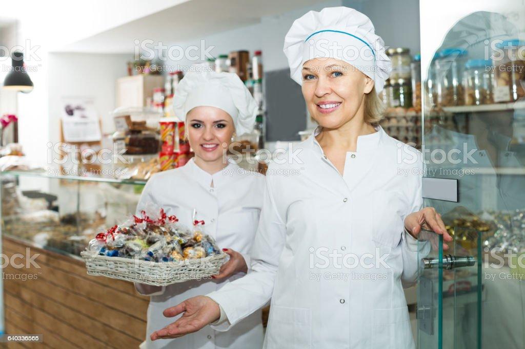 Chefs meeting customers at door stock photo