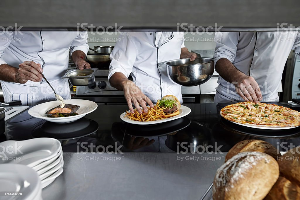 Chefs on kitchen stock photo