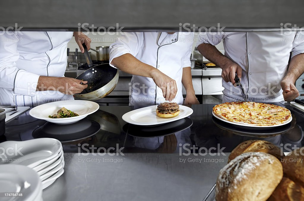 Chefs on kitchen royalty-free stock photo