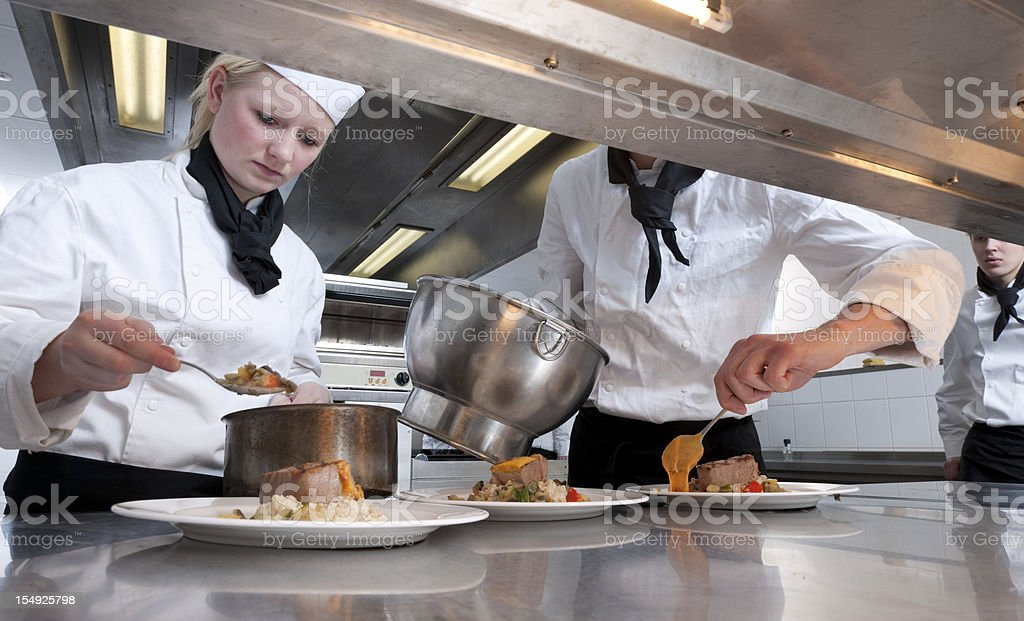 chefs preparing dishes with grilled tuna steak royalty-free stock photo