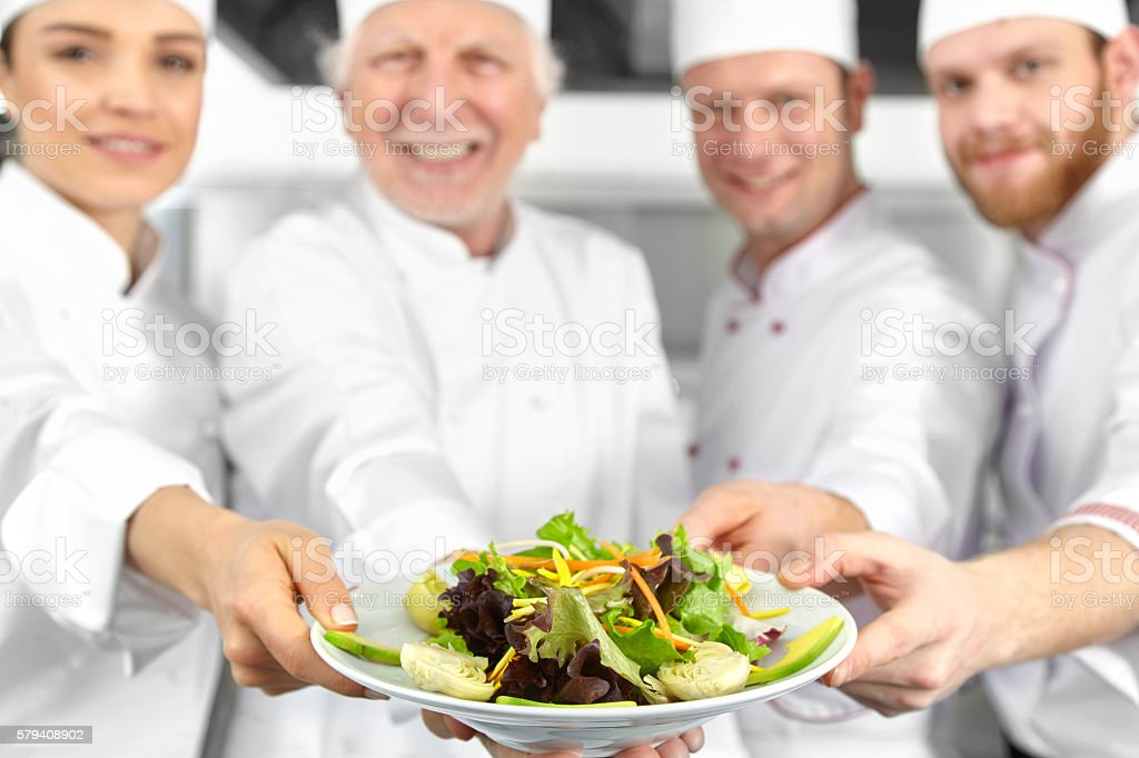 Chefs presenting salad stock photo