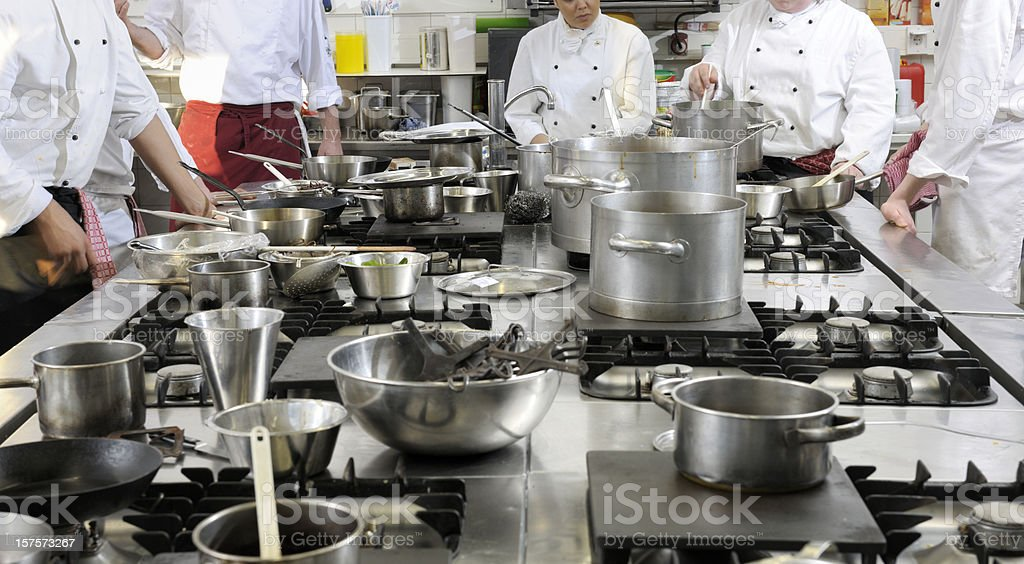 chefs standing around stove ready to cook dinner royalty-free stock photo