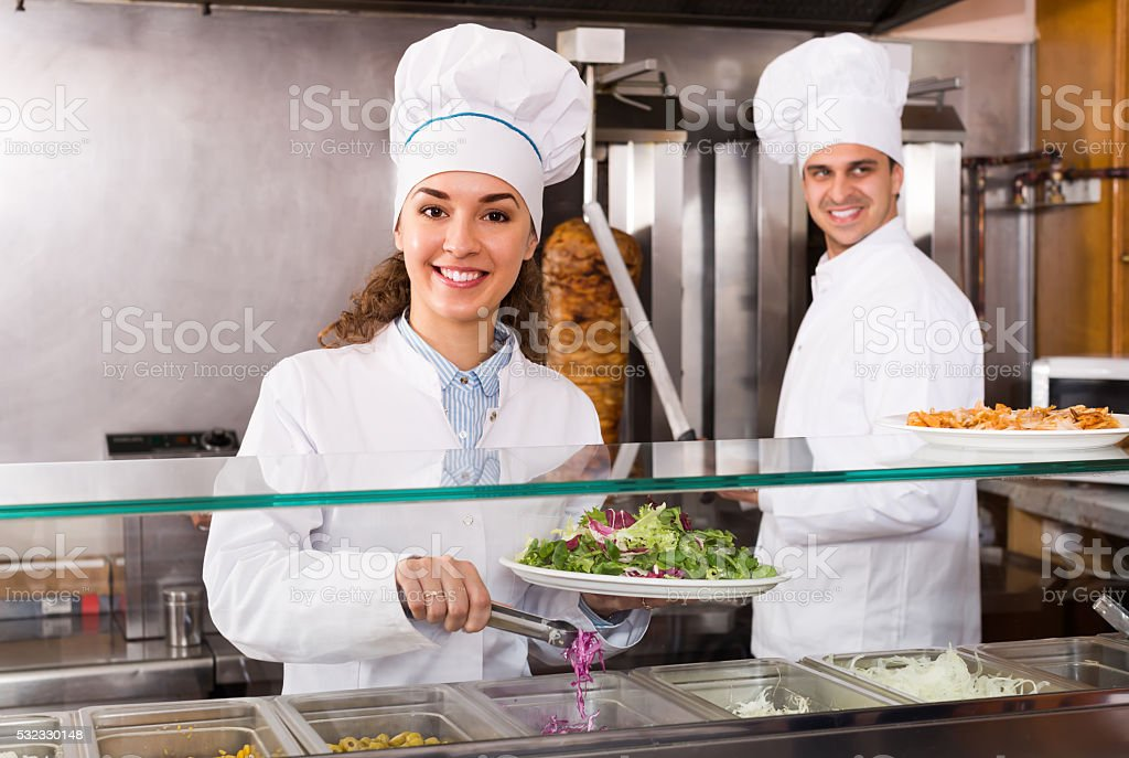 Chefs with kebab and salad at bistro stock photo