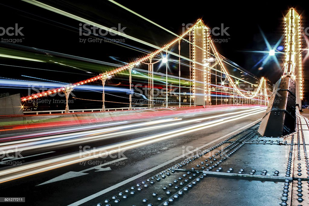 Chelsea Bridge at night in London with Bus Lights stock photo
