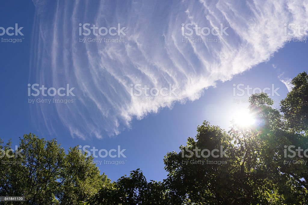 Chem Trails Angels Wing Sunlight Clouds Blue Sky stock photo