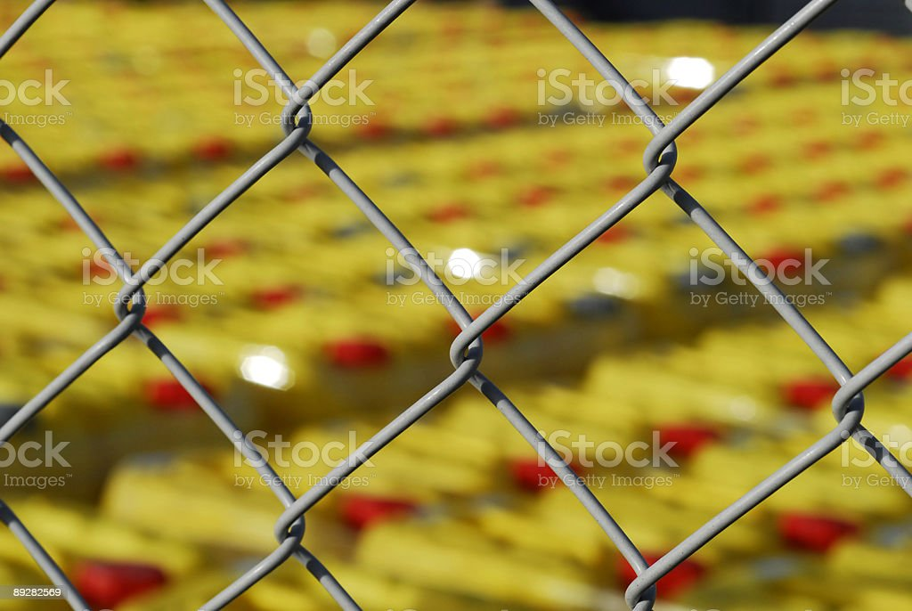Chemical cans behind fence royalty-free stock photo