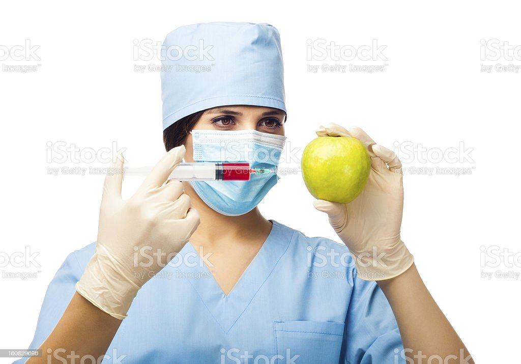 Chemical experiment with apple and syringe royalty-free stock photo