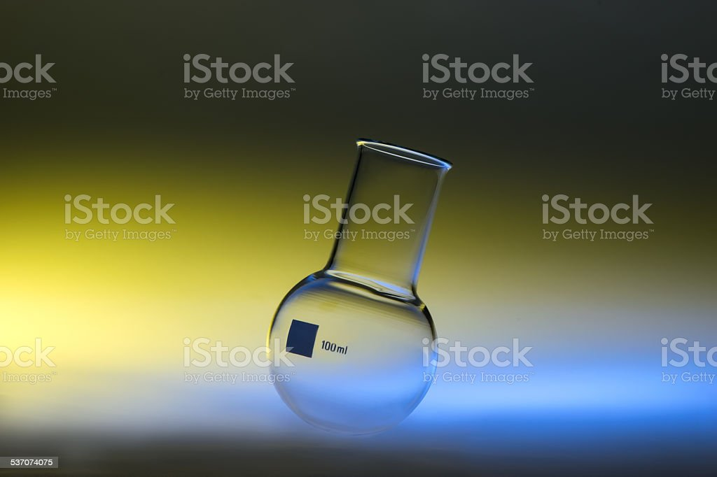 chemical flask in diffuse light stock photo