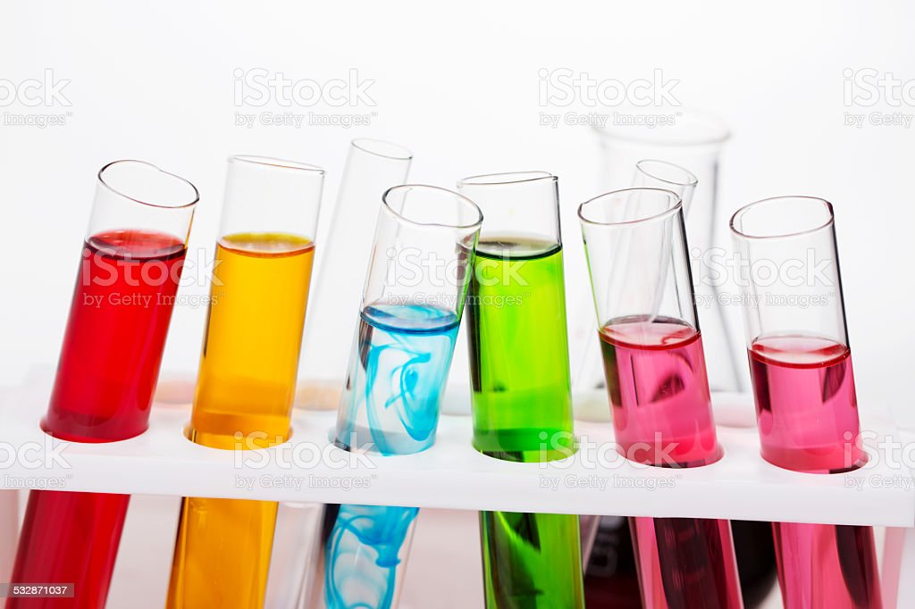 Chemical flask with a  laboratory test tubes inside stock photo