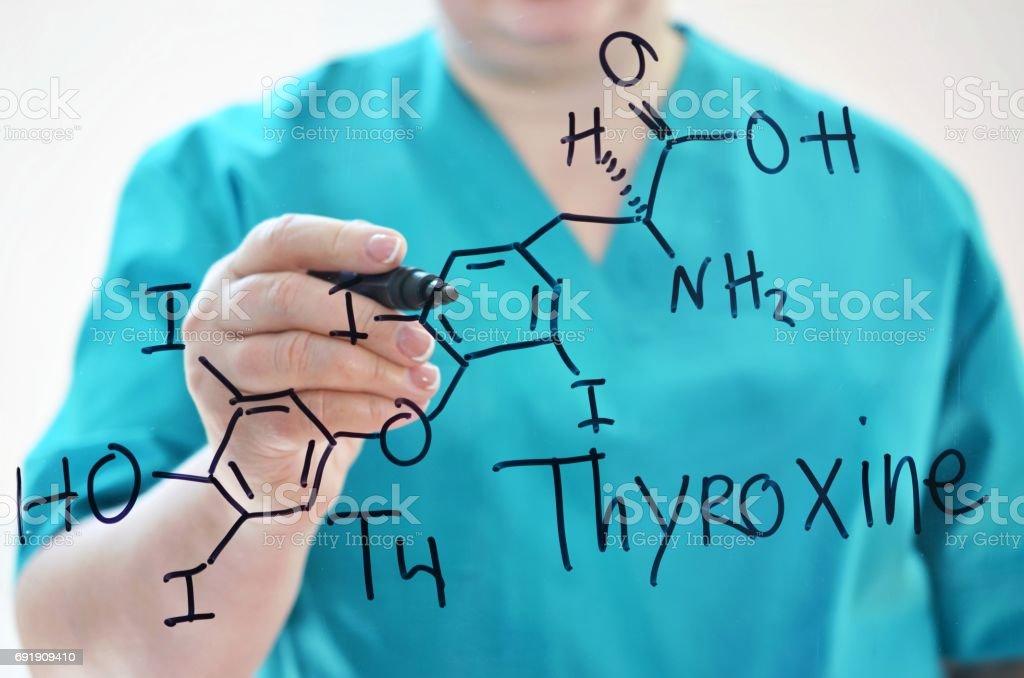 Chemical formula of Thyroxine. T4. stock photo