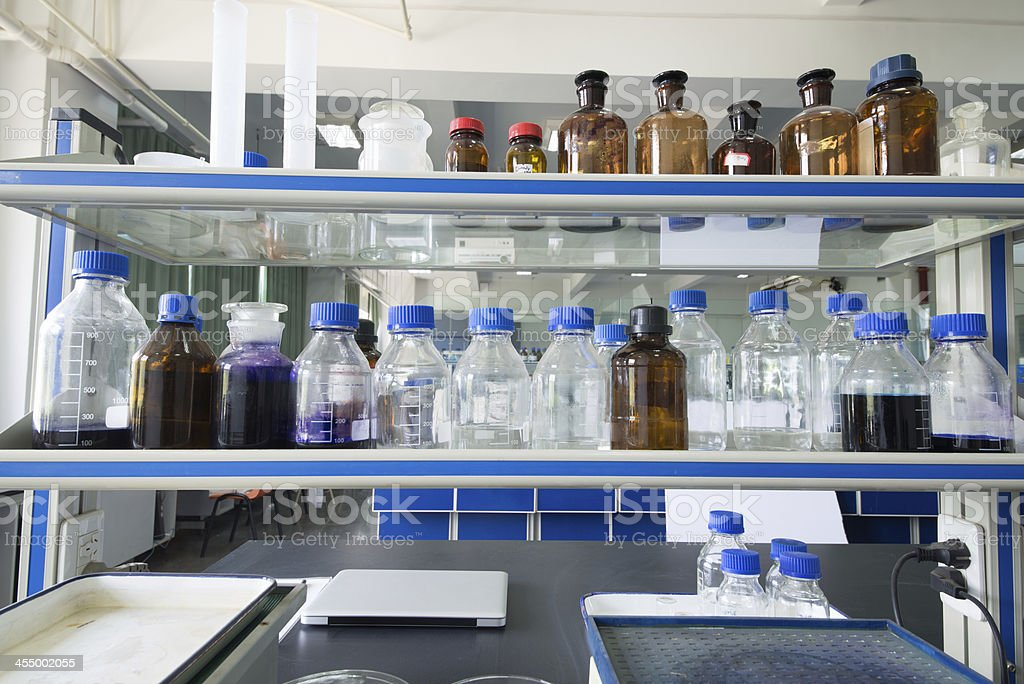 Chemical Glass Bottles in Laboratory stock photo