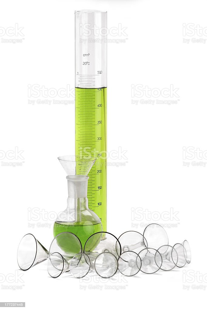 Chemical glassware with green liquid royalty-free stock photo